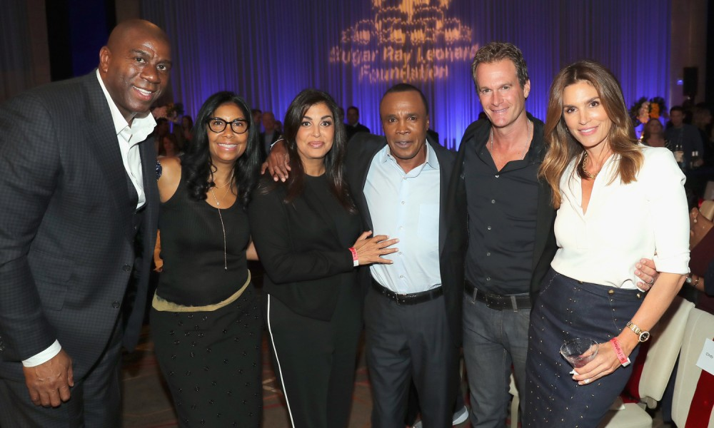 "HOLLYWOOD, CA - MAY 25:  Magic Johnson, Earlitha Kelly, Bernadette Leonard, Sugar Ray Leonard, Rande Gerber and Cindy Crawford attend B. Riley & Co. and Sugar Ray Leonard Foundation's 7th Annual ""Big Fighters, Big Cause"" Charity Boxing Night at Dolby Theatre on May 25, 2016 in Hollywood, California.  (Photo by Mark Davis/Getty Images for Sugar Ray Leonard Foundation ) *** Local Caption *** Magic Johnson; Earlitha Kelly; Rande Gerber; Cindy Crawford; Bernadette Leonard; Sugar Ray Leonard"